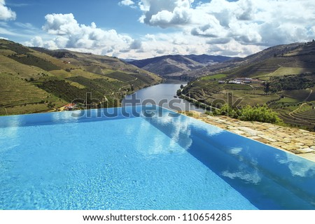 swimming pool over douro river - stock photo