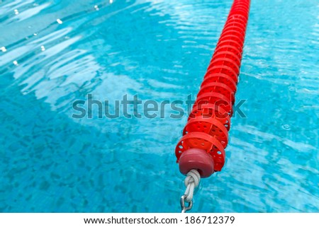 swimming pool red lane and wave - stock photo