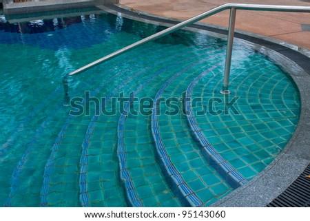 swimming pool step - stock photo