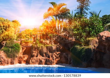 swimming pool. Sunset in Tenerife island, Spain. Tourist Resort - stock photo