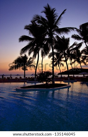 swimming pool sunset parasol  lagoon and coastline in madagascar nosy be