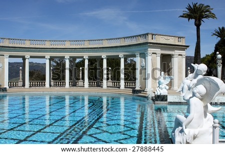 swimming pool surrounded by roman sculptures - stock photo