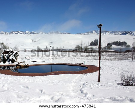 Swimming pool surrounded by snow - stock photo