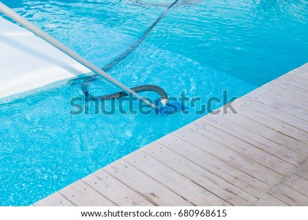 swimming pool vacuum cleaner close up view pool cleaning process pool maintenance pool