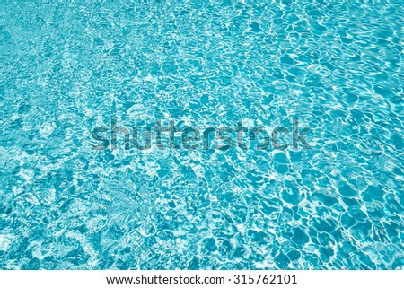 Swimming pool water with shiny sunlight reflection