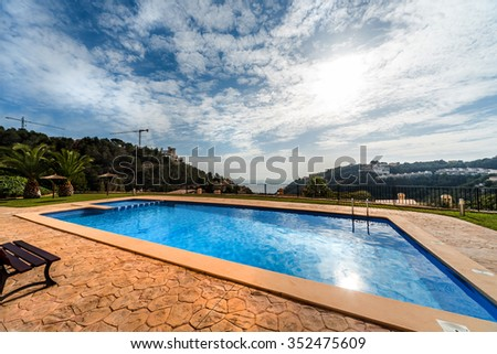 Swimming pool with a scenic landscape - stock photo