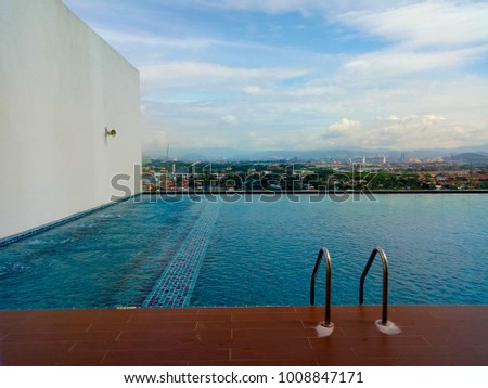 Swimming pool with blue sky background