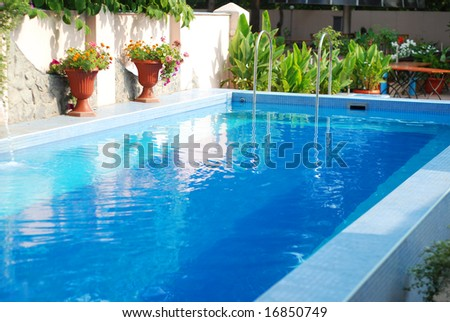 Swimming pool with clean blue water outdoor