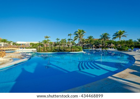 Swimming pool with deep blue sky and dark blue water at the luxury Caribbean, tropical resort. - stock photo