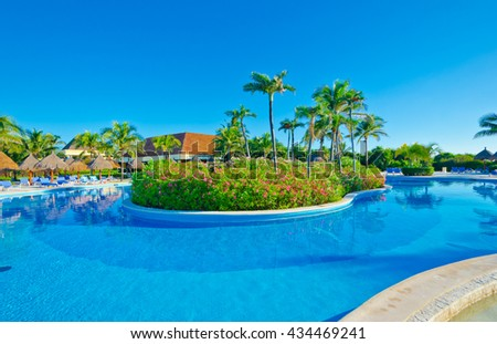 Swimming pool with deep blue sky and dark blue water at the luxury Caribbean, tropical resort.