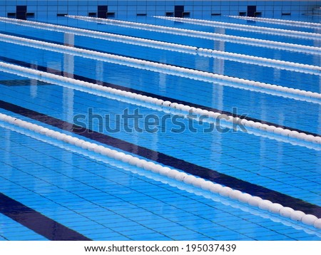 Swimming Pool With Lanes Marked By Ropes And Floats Stock Photo