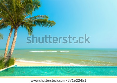 Swimming pool with Palm tree at beach