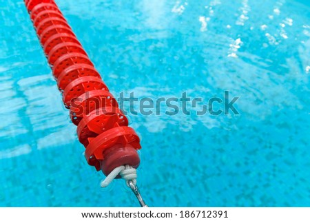 swimming pool with red lane - stock photo