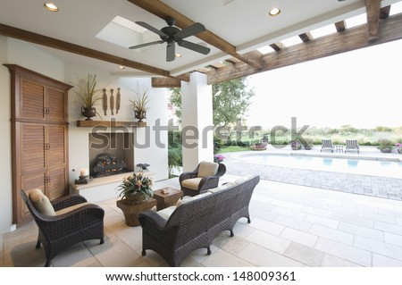 Swimming pool with seating area in outdoors room - stock photo