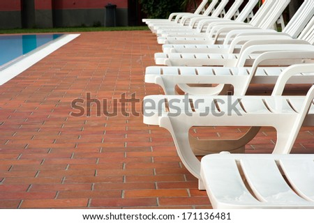 swimming pool with some chairs - stock photo