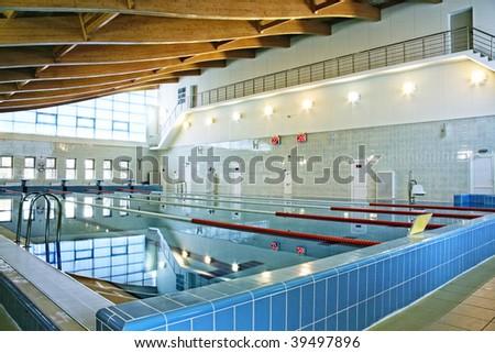 Swimming pool with spectator balcony interior photo - stock photo