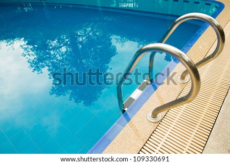 Swimming pool with stair - stock photo