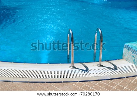 Swimming pool with stair and green relaxing water - stock photo