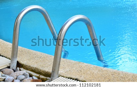 Swimming pool with stair at hotel in Thailand, Sport club - stock photo