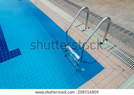 swimming pool with stair at sport center. - stock photo
