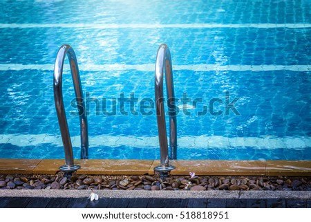 Swimming pool with stair in close up view