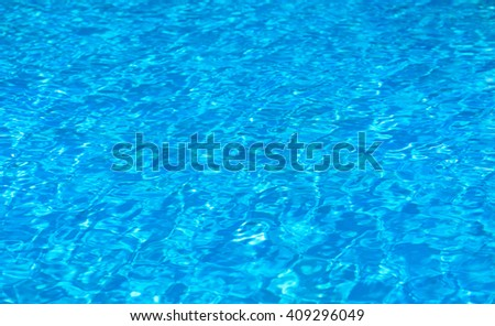 swimming pool with sunny reflections - stock photo