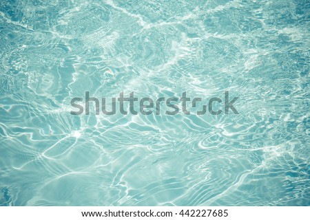 swimming pool with sunny reflections background - stock photo