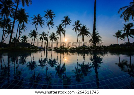 Swimming pool with sunrise - stock photo