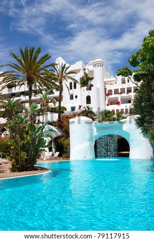 Swimming pool with waterfall and building of luxury hotel, Tenerife island, Spain - stock photo