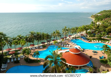 Swimming pools and bar at the beach of luxury hotel, Pattaya, Thailand - stock photo