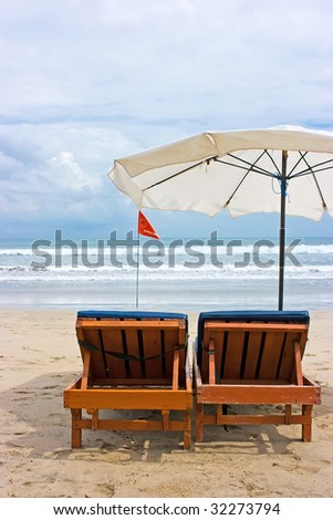 Swimming prohibited red flag on Kuta beach - stock photo