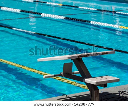 Swimming starting blocks - stock photo