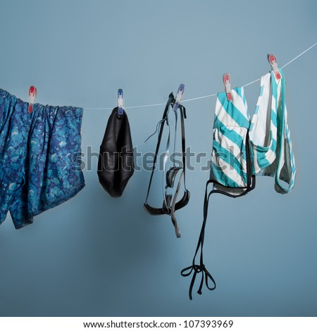 Swimming suit are hung on the clothesline - stock photo