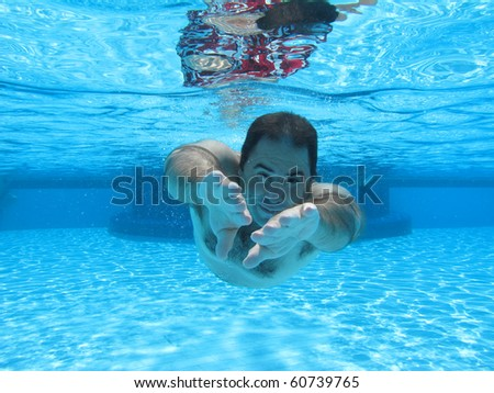 swimming underwater photo - stock photo