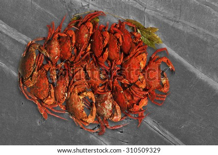 swimming  velvet crabs , necora of Galicia atlantic coast, cooked  isolated over slate stone background - stock photo