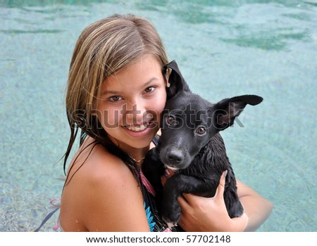 swimming with pet dog