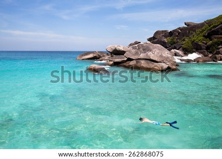 swimming with snorkel in turquoise water near paradise island - stock photo