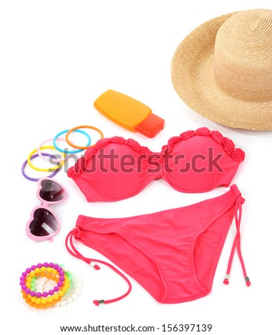 Swimsuit and beach items isolated on white