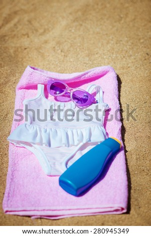 swimsuit, towel and sun cream. Accessories Beach - stock photo