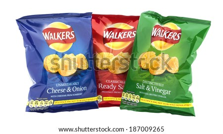 SWINDON, UK - APRIL 13, 2014:  Three packets of Walkers crisps  isolated on a white background. Walkers is a British snack food manufacturer  - stock photo