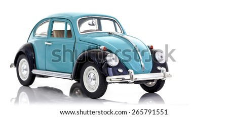 SWINDON, UK - APRIL 1, 2014:  VW Beetle in Blue Die cast model on a white background. - stock photo