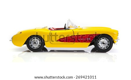 SWINDON, UK - APRIL 11, 2015: 1957 Yellow Chevrolet Corvette convertible on a white background