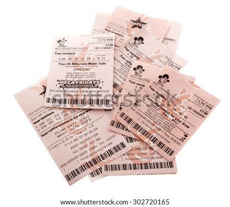 SWINDON, UK - AUGUST 2, 2015: New and old Style Euromillions  and Lotto Lottery Tickets on a White Background - stock photo