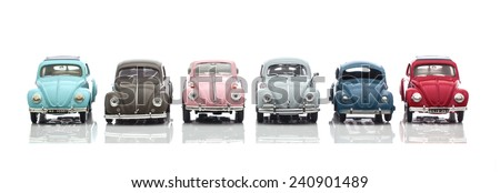 SWINDON, UK - DECEMBER 31, 2014: Collection Of  Old VW Bettle Cars Made By Corgi on a White Background - stock photo