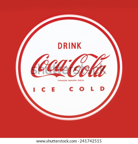 SWINDON, UK - DECEMBER 2, 2014: Vintage Coca-Cola sign showing the Drink Ice Cold Coca-Cola Trade Mark Reg. - stock photo