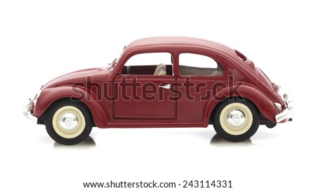 SWINDON, UK - DECEMBER 14, 2014:  VW Beetle in Red, Die cast model on a white background. - stock photo