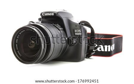 SWINDON, UK - FEBRUARY 16, 2014: Canon 1100D DSLR Camera on a white background - stock photo
