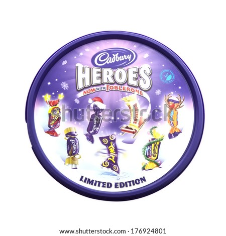 SWINDON, UK - FEBRUARY 16, 2014: Tin of  Cadburys Heroes Assorted Chocolates on a whire background. - stock photo
