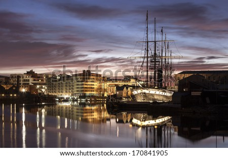 SWINDON, UK - JANUARY 12 2014: Brunel's, SS Great Britain by night showing the Bristol water front - stock photo