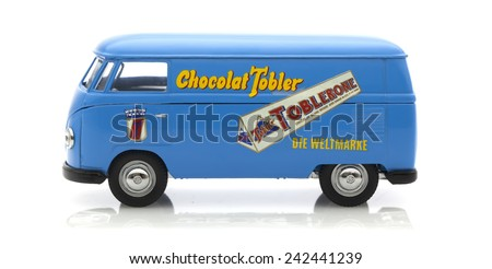 SWINDON, UK - JANUARY 8, 2015:  Old VW Van Made By Corgi with Toblerone Logs on a White Background - stock photo